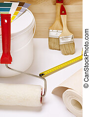 home improvement - conceptual photo with paint , roller and...