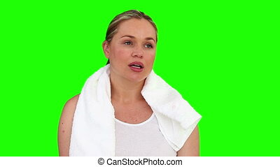 Pretty woman after sport against a green screen