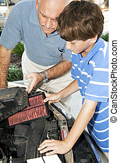 Replacing Dirty Air Filter - Father teaches his son how to...