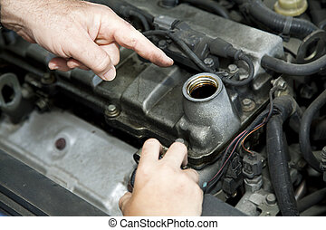 Car Repair - Changing Oil - Father's hand pointing to the...