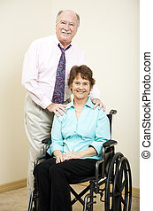 Business Partners - Wheelchair - Businesswoman in a...