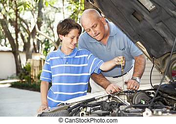 Checking the Oil - Father and son working on the car...
