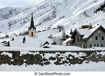 Alpine Village - An alpine village after a heavy snowfall,...