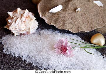 Bath sea salt on black granite flooring tiles