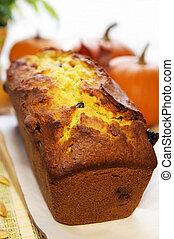 Loaf of autumn pumpkin bread on a wooden board