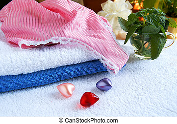 Spa accessories - Colorful towels, pyjamas and bath aroma...