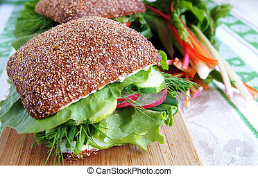 Healthy rye bread sandwich with radish and cucumber - Big...