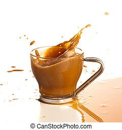 coffee splashing into cup on a white background