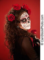 Woman with face paint in Day of the Dead style - Young woman...
