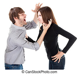 Couple in physical argument - Young Caucasian woman holding...
