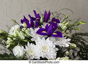 Bouquet of white chrysanthemums, roses and irises