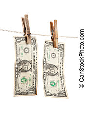 dollar is hanging on a wooden clothespin isolated on white...