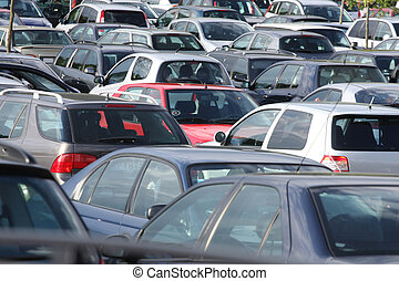 Parking lot with many cars of various colors