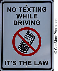 No texting while driving, its the law sign - no texting...