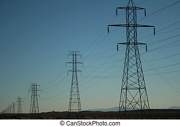 power transmission lines - rows of electric power...