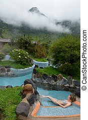 young woman in thermal bath, highland spa resort