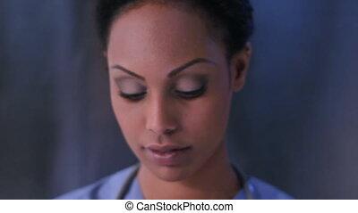 Nurse and needle. - Female nurse holds up needle and...