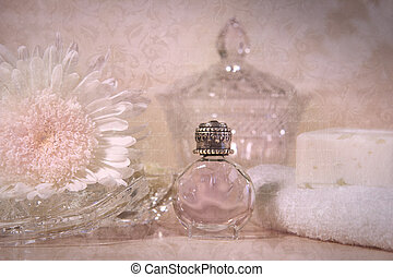 Vintage perfume bottle with flower and soap