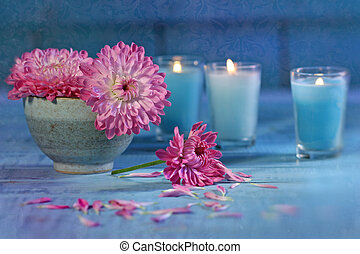 Chrysanthemum flowers with candles - Chrysanthemum flowers...