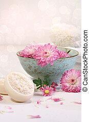 Spa scene with  chrysanthemum flowers in water and soap