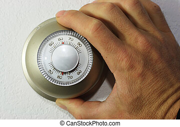 setting thermostat - hand setting a thermostat down to 62...