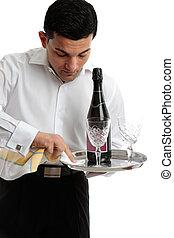 Waiter or servant preparing tray - A waiter or servant at...