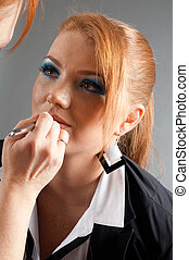 professional visagiste with red lipstick - Which girl of a...