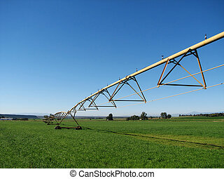 farm irrigation system - pivot irrigation system in a green...