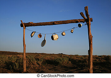 pots and pans road sign - pots and pans strung up on a frame...