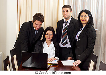 Four business people working