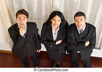 Top view of three business people looking up - Top view of...