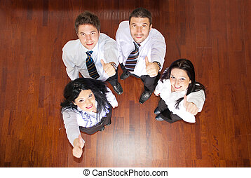 Top view of business people giving thumbs - Top view of four...