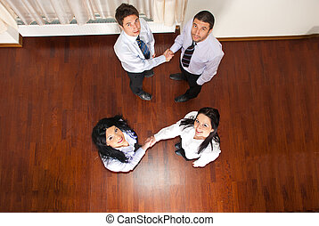 Top view of business people hand shakes - Top view of two...