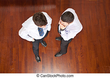 Top view of business men telling secret - Top view of...