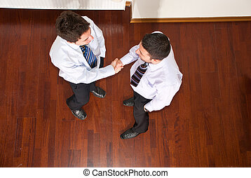 Top view of business men hand shake - Top view of two...