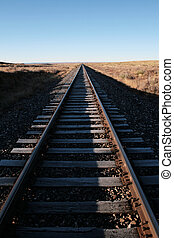 railroad tracks extend straight to the horizon