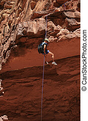 asian woman rappels - canyoneering asian woman rappels off a...