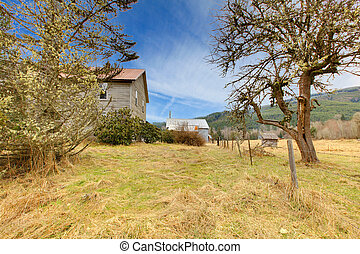 Old grey rustic house with winter country landscape - Build...
