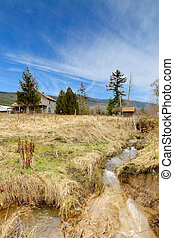 Country landscape with an old house in the distance - Build...