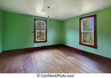 A very old empty room with bright green walls - Build in...