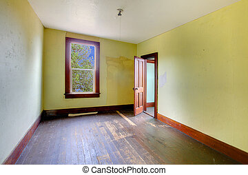 A very old empty room with bright yellow walls - Build in...