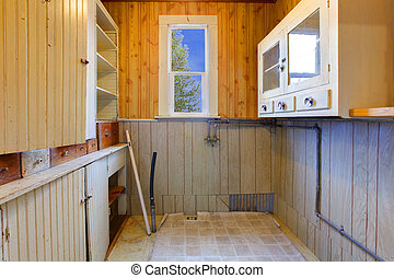Pantry or kitchen closet with shelves in historical old farm...