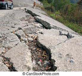 Damaged Road - A narrow road has been damaged by an...