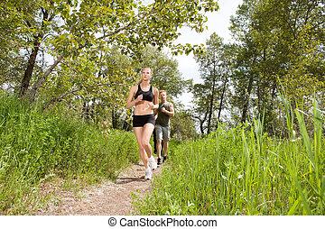 People in sportswear jogging