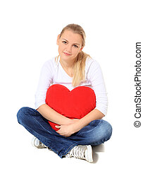In love - Attractive blonde woman holding heart-shaped...
