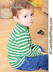 Toddler in kindergarten - Cute caucasian toddler in...