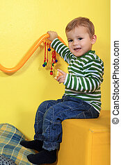 Kindergarten - Cute european toddler having fun in...