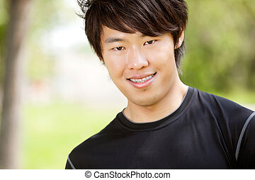 Portrait of a young man smiling - Portrait of a man smiling...