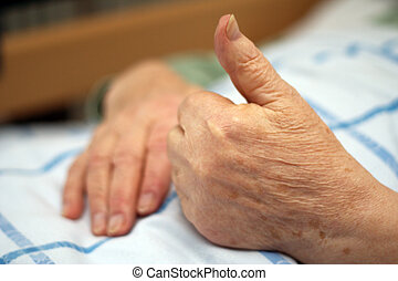 Excellent elder care - Care-dependent person showing thumbs...