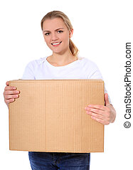 Carrying moving box - Attractive blonde woman carrying...
